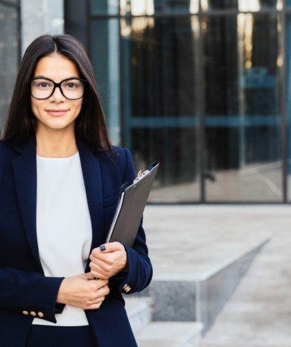 portrait-of-young-successful-businesswoman-wearing-glasses-and-looking-to-camera-professional-female_t20_bA0NWB.jpeg